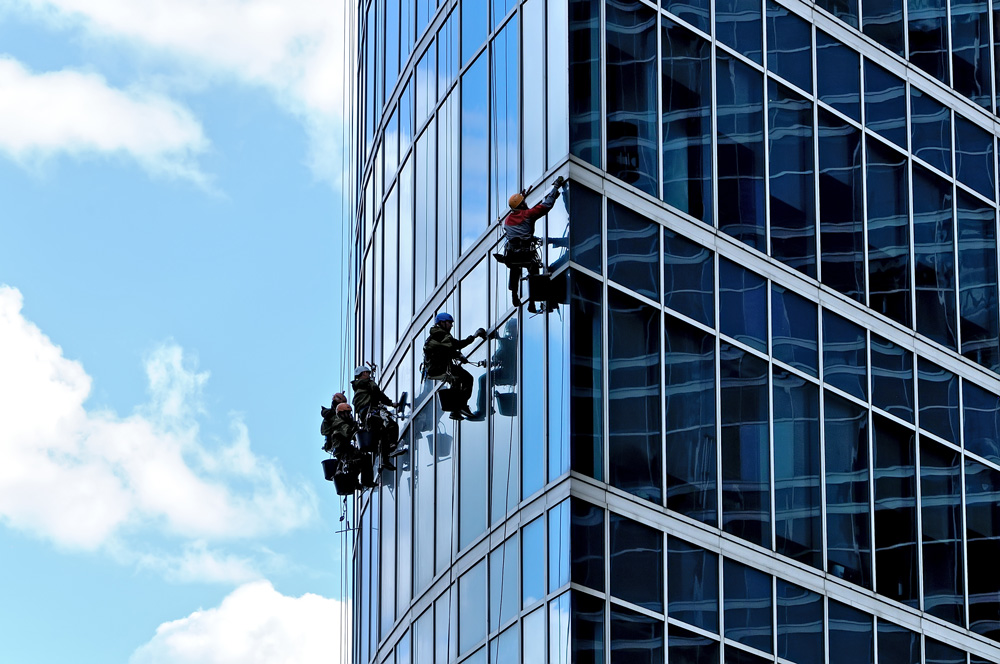 Abseiling cleaning being done on skyscraper