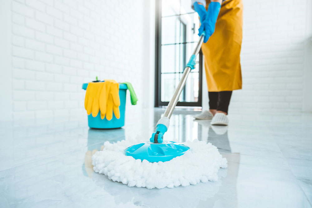 Person cleaning floor after builders work